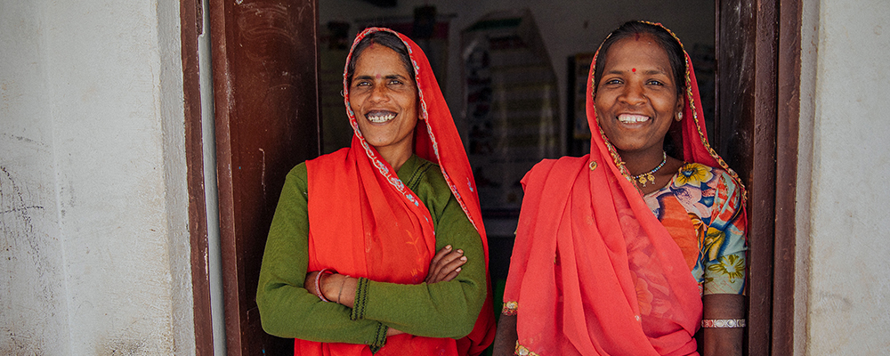 Two mothers who work at a local health and maternal care centre in India
