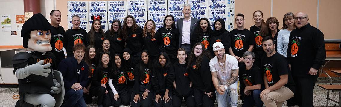 St. Thomas More students with singer Karl Wolf and Ford Canada CEO Dean Stoneley.