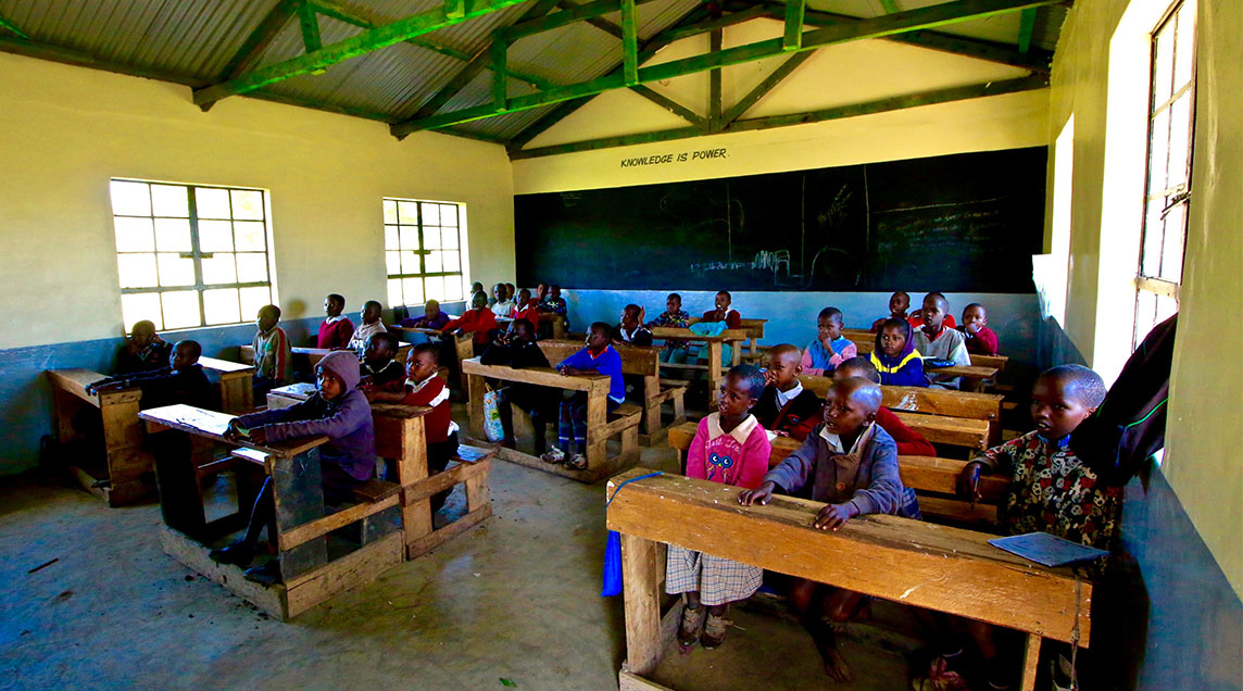 Local students in classroom in WE Villages partner community