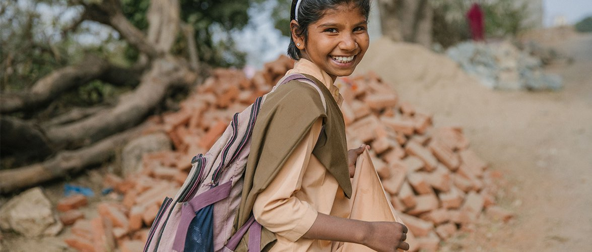 Local female student walking to school in India