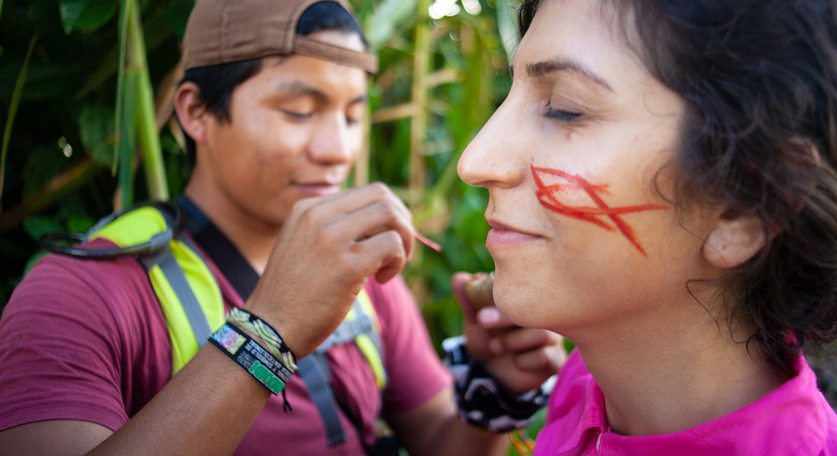 A woman has face paint applied.