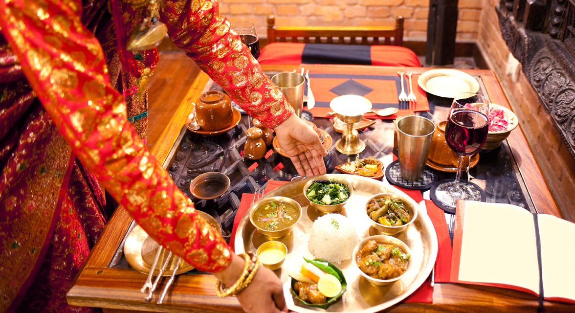 A spread of traditional Indian food on a decorative table