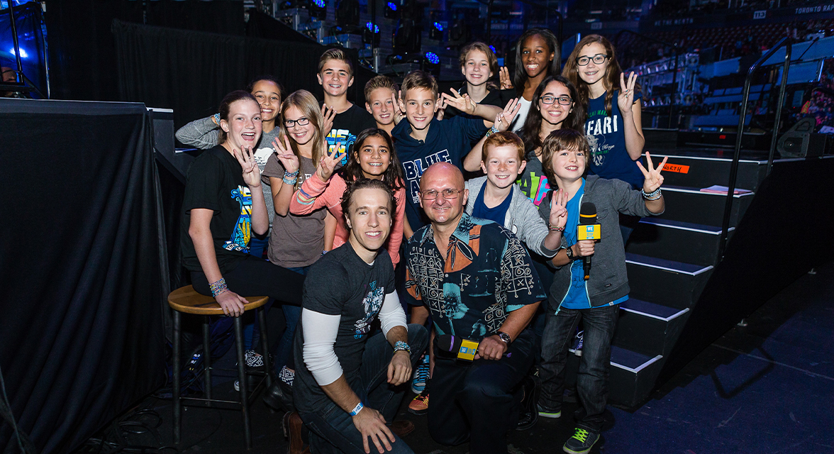 Craig Kielburger backstage with students at WE Day event