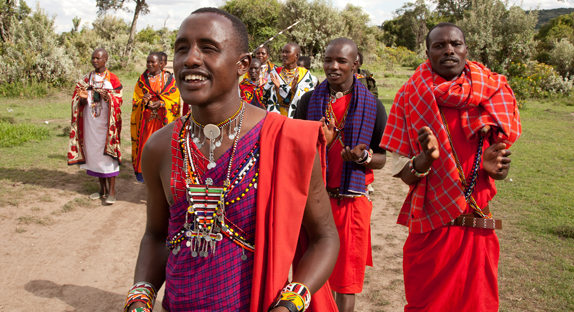Local Maasai Mara warriors celebrate in song