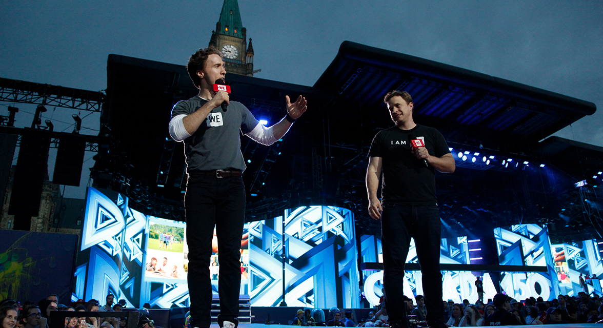 Craig and Marc Kielburger speaking at WE Day Canada 150 on Parliament Hill