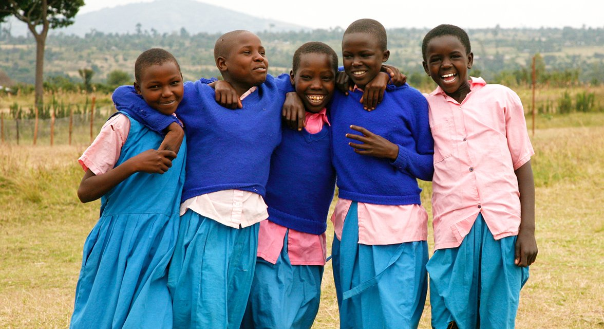 Young local students laughing together in Kenya