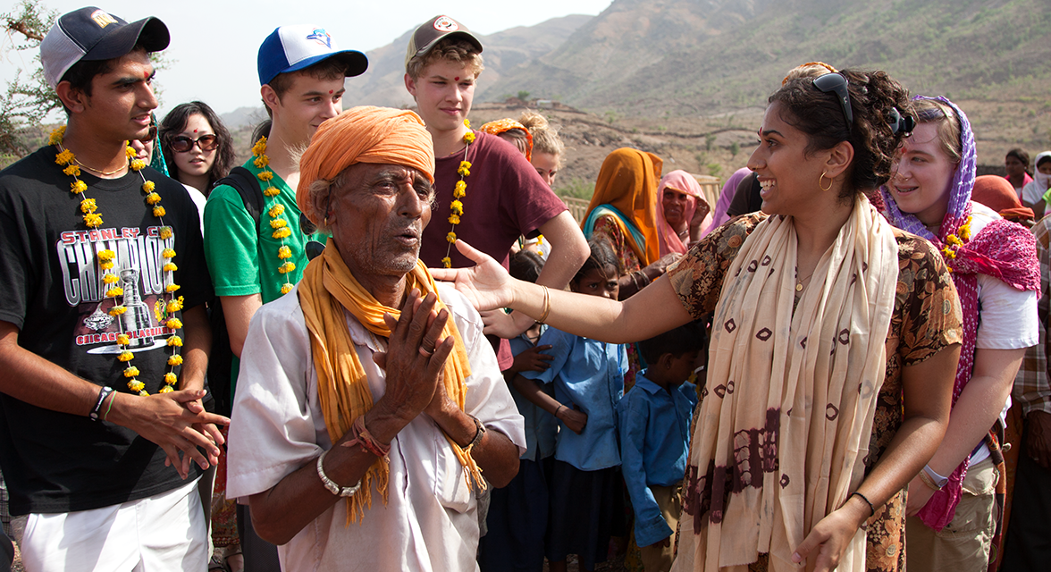 Young travellers meeting a local community member in India