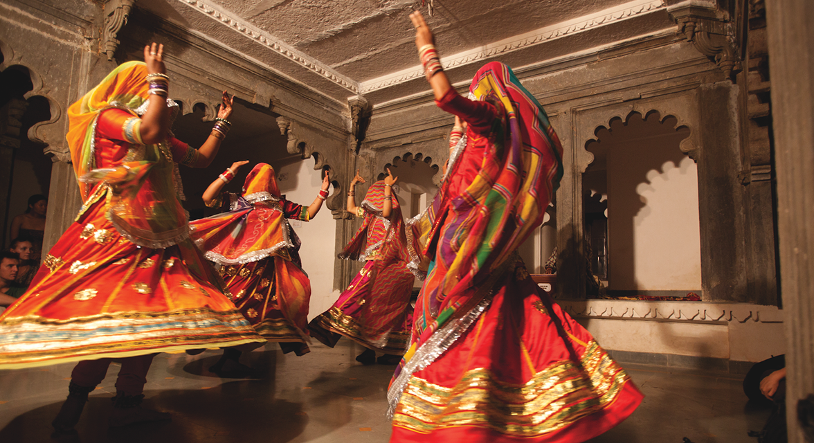 Local women in traditional clothing dancing in India