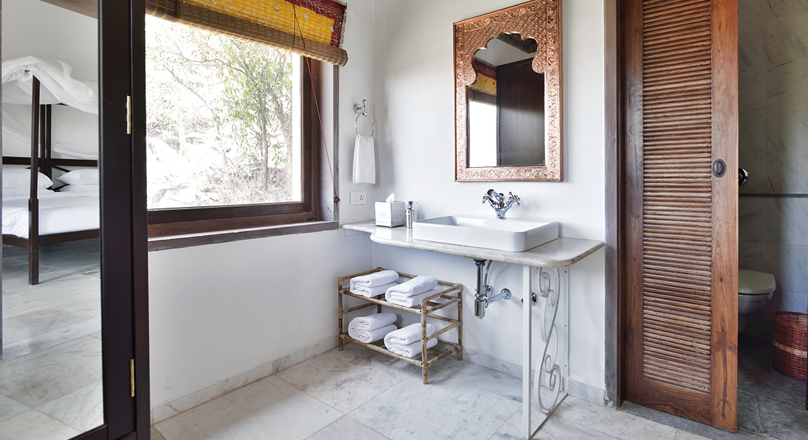 Luxurious bathroom facilities at Araveli Cottages and Tented Camp