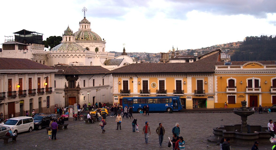 Quito city square with travellers walking around