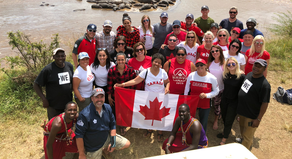 Canadian Travellers holding up the Canadian flag