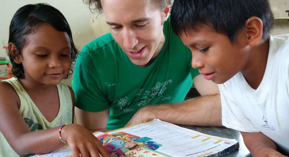 Craig Kielburger with students in a classroom in Ecuador