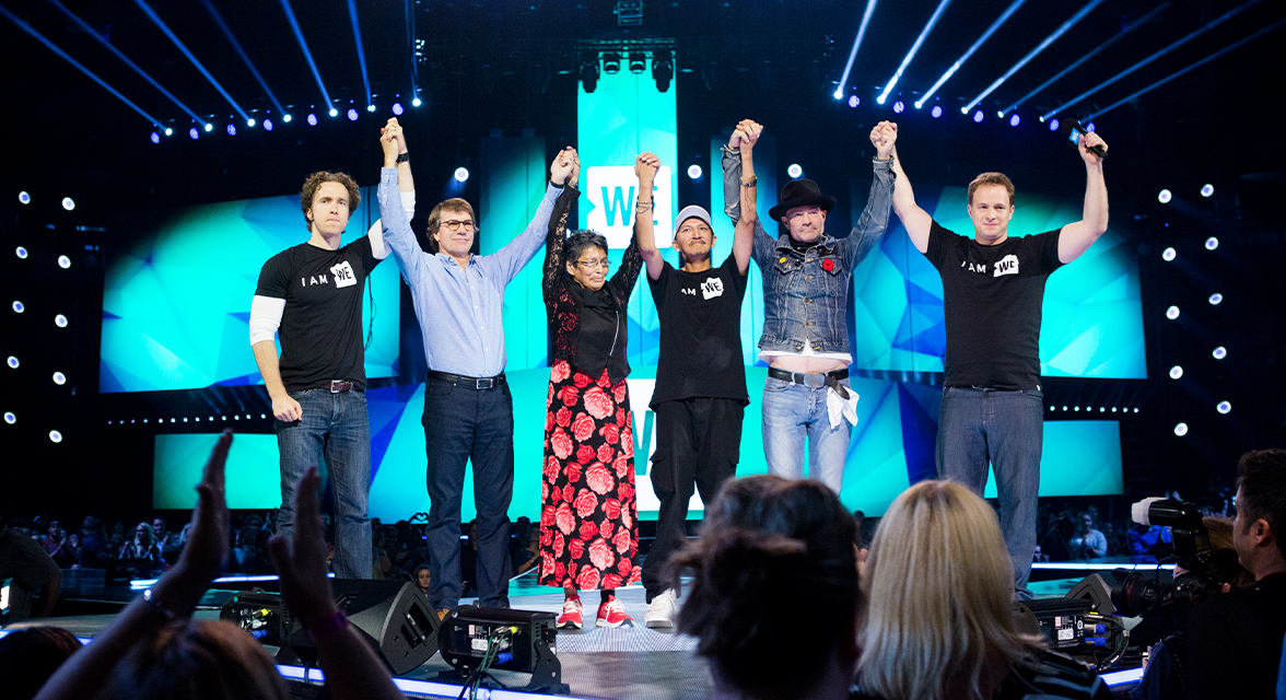 Craig and Marc Kielburger, Gord Downie and Wenjack family members at WE Day event