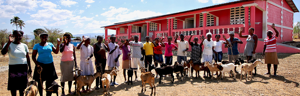 Graduates from a goat-raising opportunity program in Haiti.