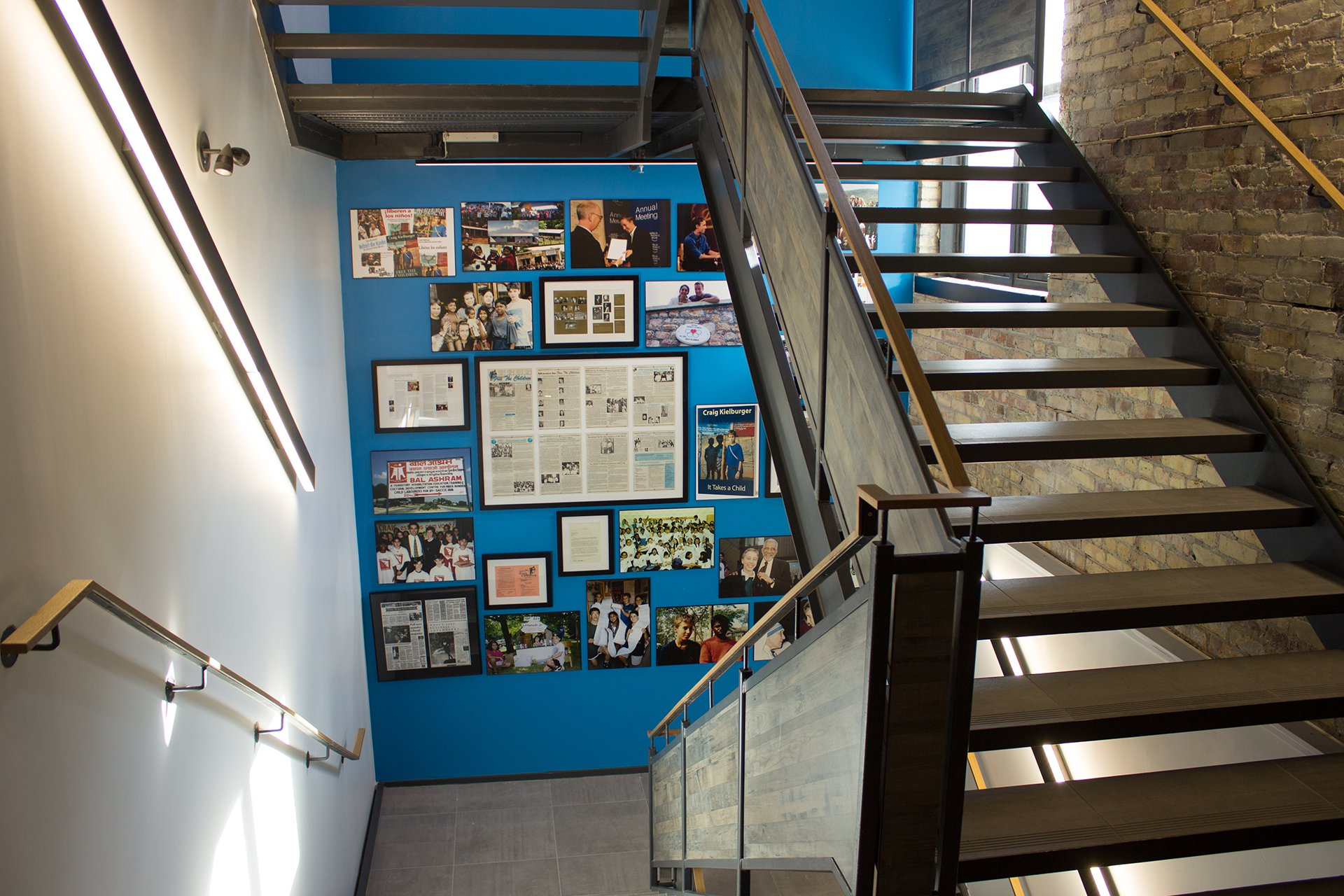 Important moments from the history of WE are displayed in a stairwell in the WE Global Learning Center