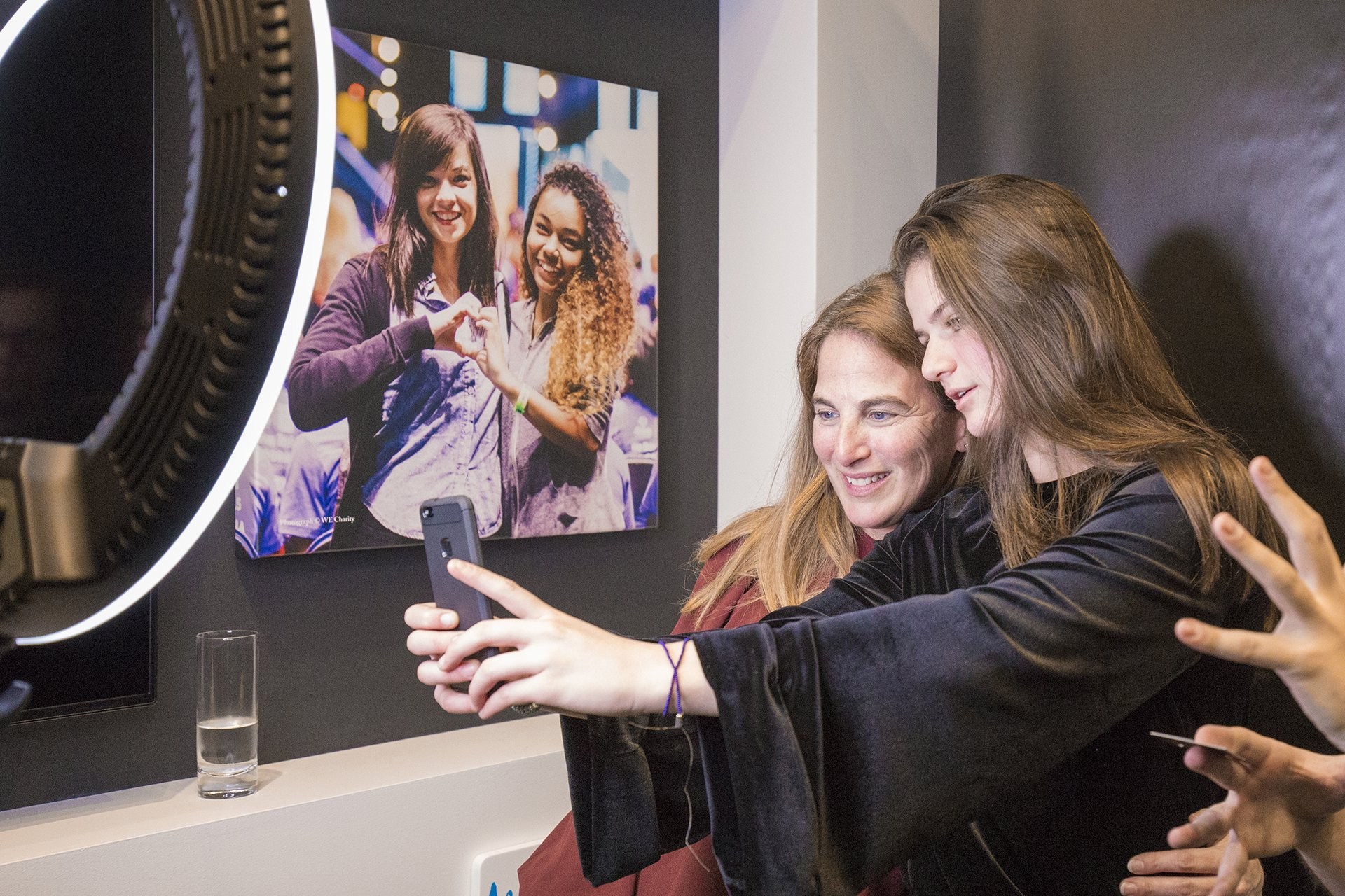 Two people take a selfie at the WE Global Learning Center