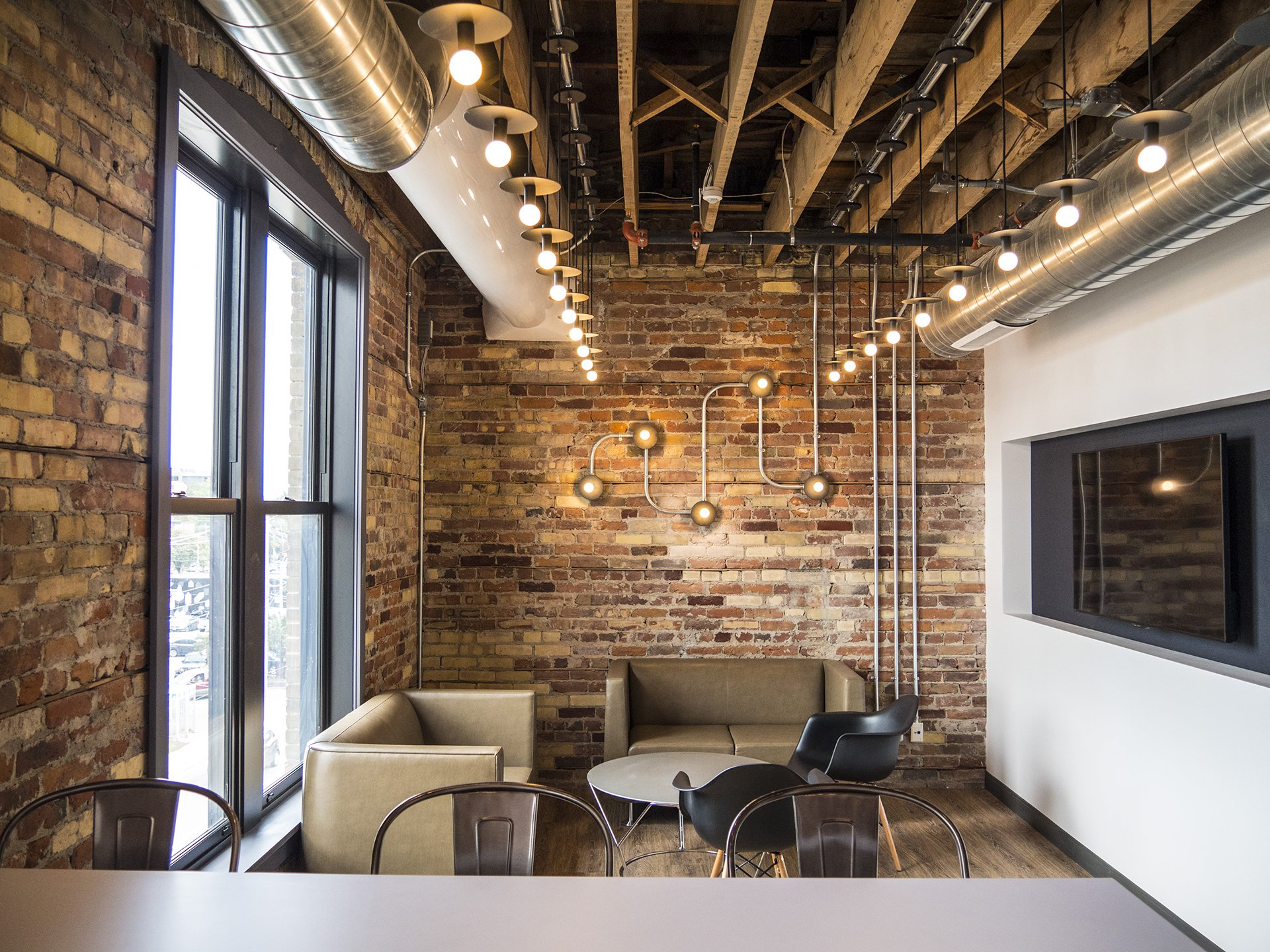 The kitchens in the WE Global Learning Center feature exposed brick and floor-to-ceiling windows