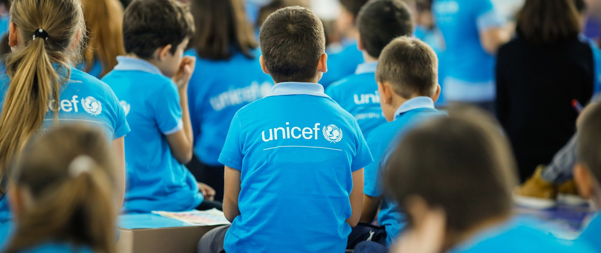 Child in a blue Unicef shirt