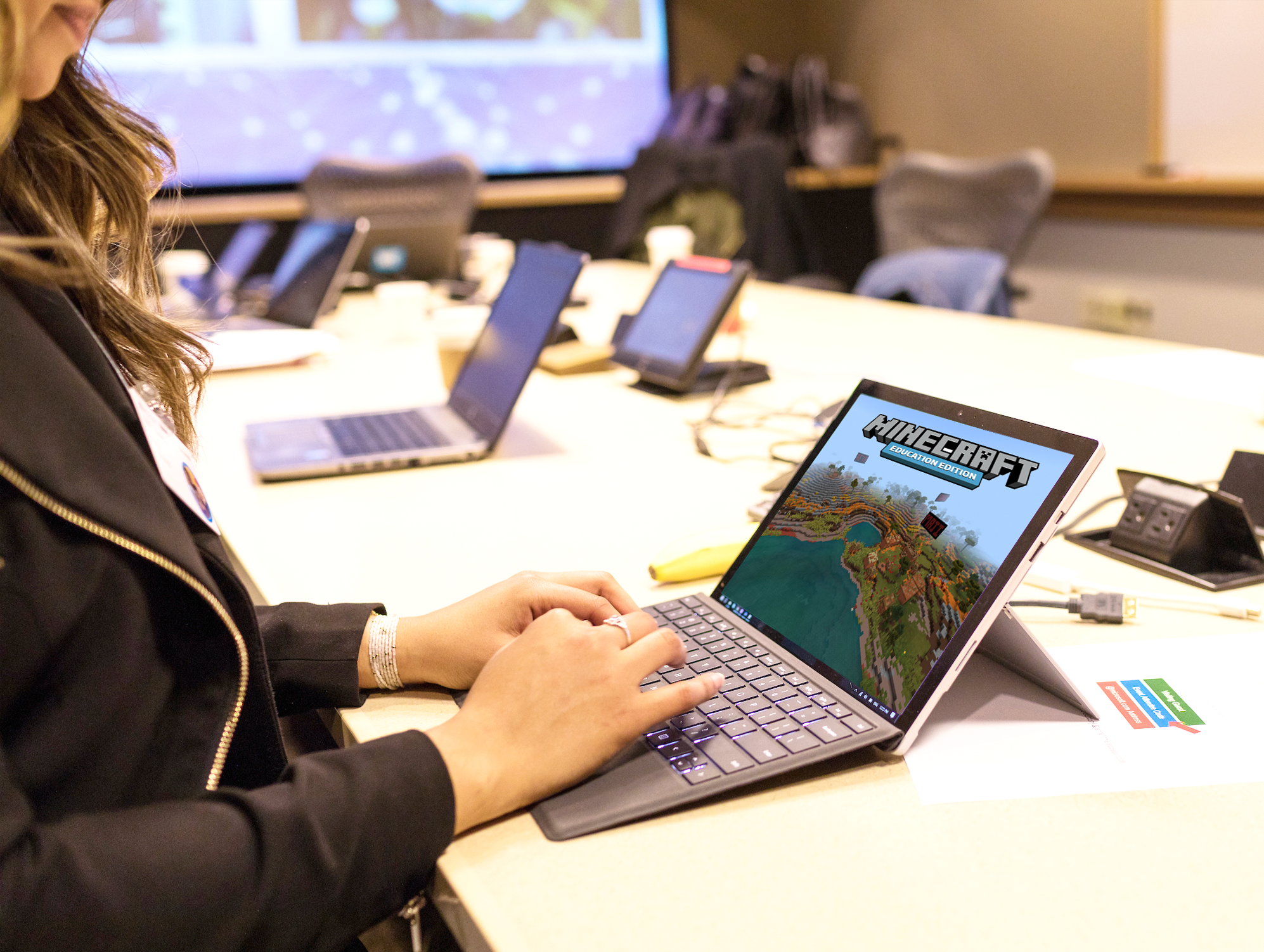 A student playing Minecraft on a laptop