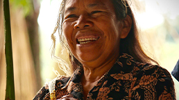 Local woman laughing in Ecuador