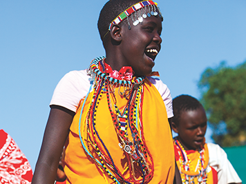 Local community members dressed in traditional clothing in Kenya