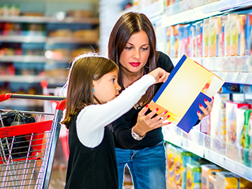 A mother and daughter reading food ingredients