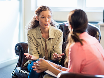 A women seeking advice from a counselor