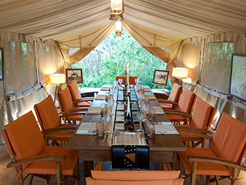 Interior of dining cabin of Bogani Cottages and Tented Camp