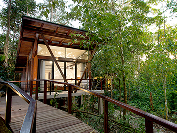 Exterior of luxurious Minga Lodge cabin in rainforest