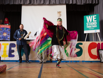 Student performing Indigenous dance for WE Stand Together campaign