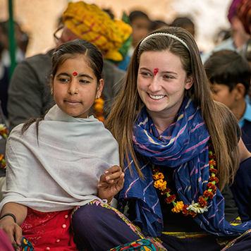 Traveller sitting with a local Indian girl