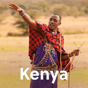 Local Kenyan community members in traditional clothing laughing with each other