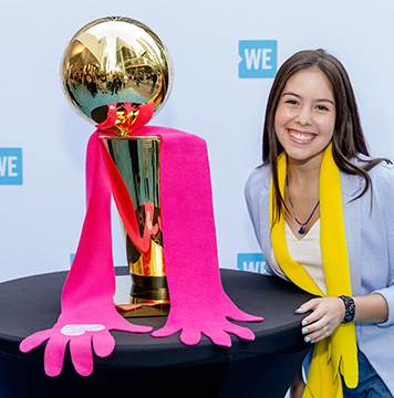 Maddison with the Larry O'Brien Championship Trophy.