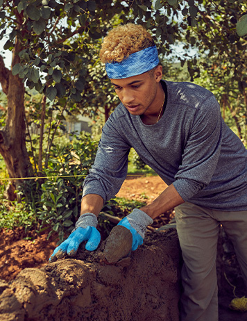 Jordan Fisher taking part in a school build