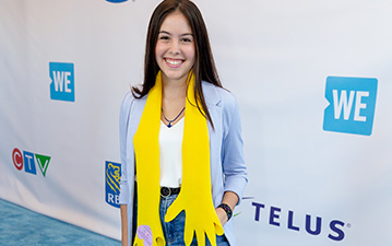 Maddison on the blue carpet with one of her scarves.