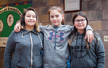 Young Indigenous students working together