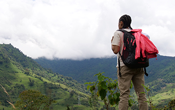 Young traveller overlooking landscape in Ecuador