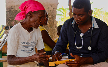 A medical worker assess a patient.