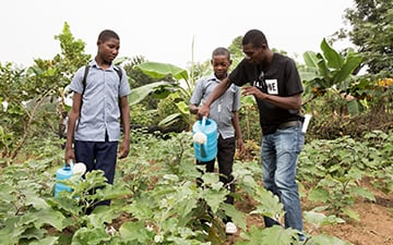 Haitian students learn in a school garden.