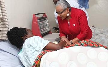 Margaret Kenyatta, the First Lady of Kenya, speaks with a doctor at Baraka Hospital on the Maasai Mara.