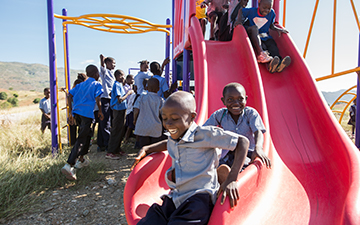 Haitian students play in a playground.