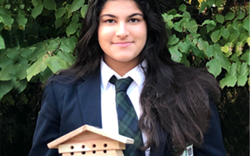 Simran Jolly with a solitary bee box.