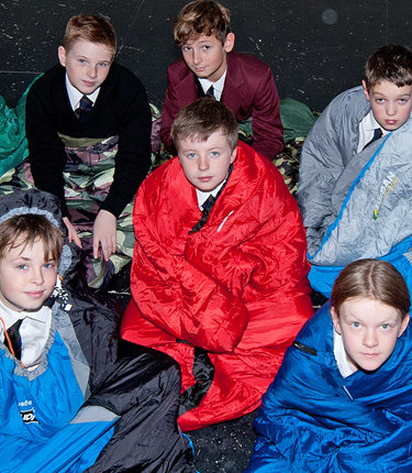 A group of students taking part in a school sleepout