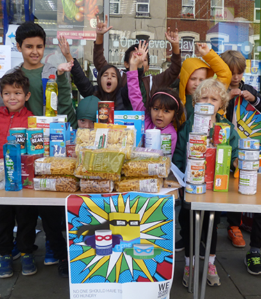 A group of students holding a food collection