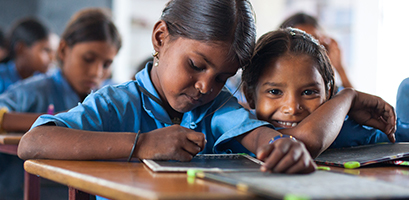 Young students focused on their school work in a classroom