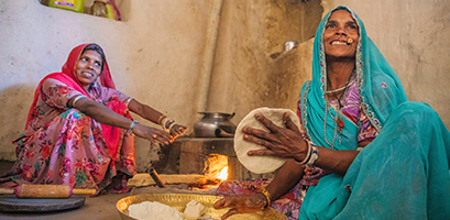 Local Indian women cooking chapatti