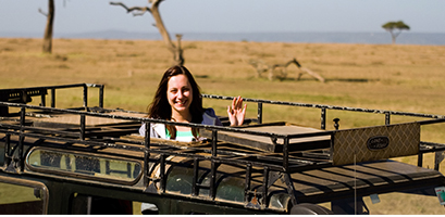 Traveller in a jeep in the savanna