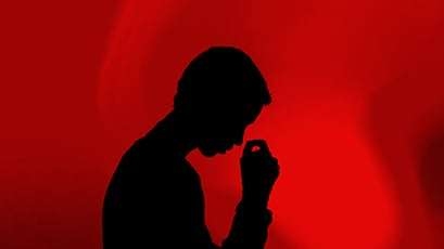 A silhouette of a young man thinking
