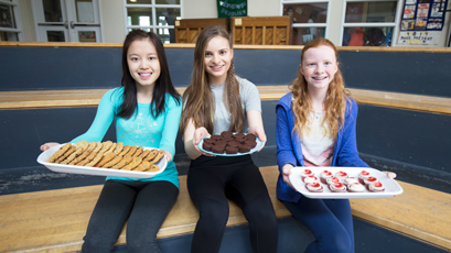 Students with baked goods for WE Bake for Change campaign