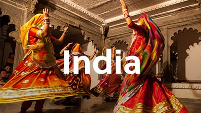Local Indian women in colorful traditional dress dancing